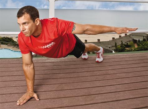 Jay Cardiello on a roof top doing 1 arm pushups
